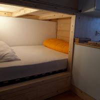 la chambre avecle lit de 140 dans l'appartement à port engaly 2